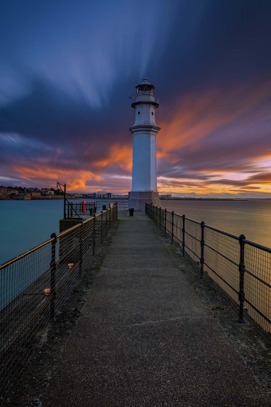 Newhaven Lighthouse Sunset  by valdi - The Moving Clouds Photo Contest