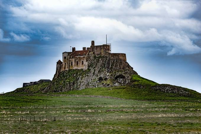 Lindisfarne Castle is a 16th-century castle located on Holy Island, near Berwick- upon-Tweed, Northumberland, England