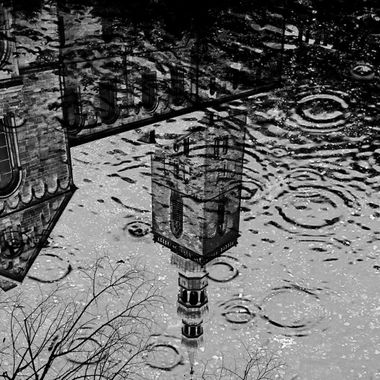 Reflection of a church in water whilst raining in Soest.