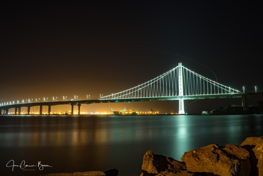 This beiutiful night shot of the Bay Bridge from a Treasure Island view point.