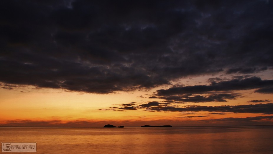 This image was taken at sunset showing Gull and Seal Islands in the Shoal Water Marine Park in Ro...