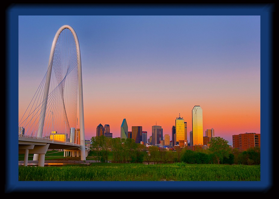 The Dallas skyline at dusk features the new Margret Hun Hill Bridge