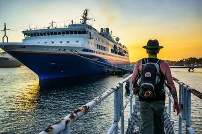 MV Explorer & Rogue Photographer