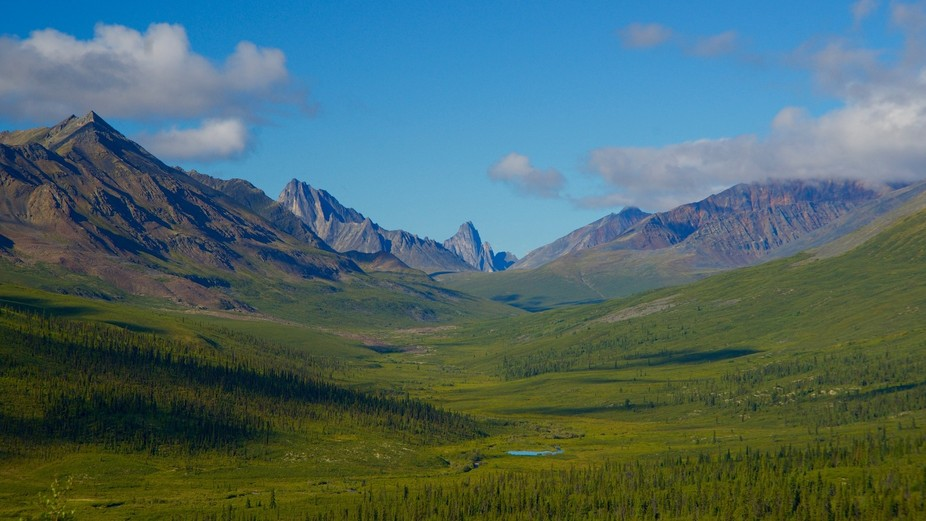 The Monolith Mountain Range in the Yukon Territory in Canada.The pointy mountain in the middle is...