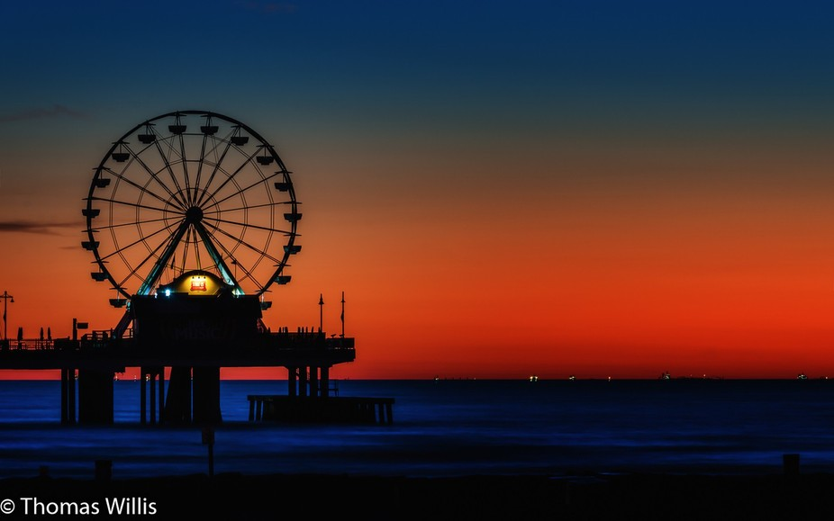 Galveston, TX, ferris wheel well before sunrise with 4 sec exposure.