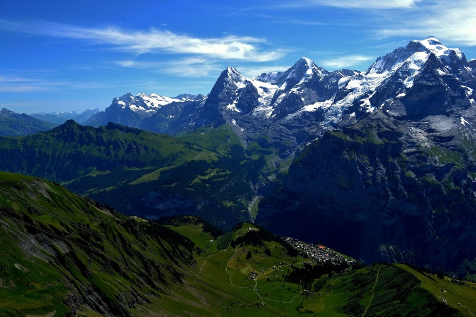 Looking down onto the tiny town of Murren from near the Schilthorn in the Swiss Alps is a breatht...
