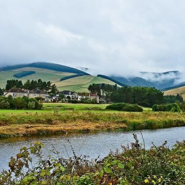 I took this photo when me and my wife were driving to Edinburgh, Scotland, in the year 2014. I saw this stream of water by the side of the road and stopped to take a photo of the scenery.