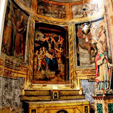 Beautiful Muriels and pictures painted in a church alcove of an Italian church.