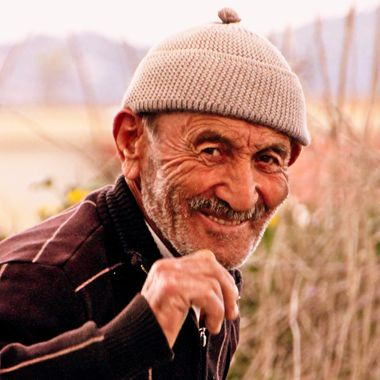 I took this photo when I went to Büyükkonuk Village with my photography students, in the year 2014. While we were walking around in the village, this villager was passing by and he was more than pleased when we started to take his photographs.