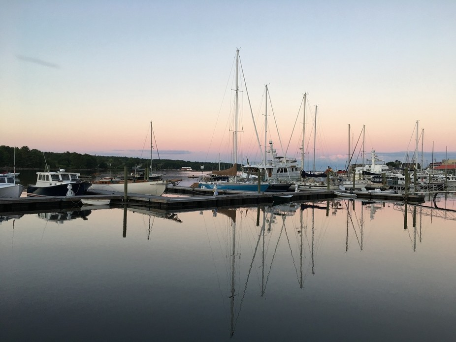 Sun setting on Belfast, Maine harbor