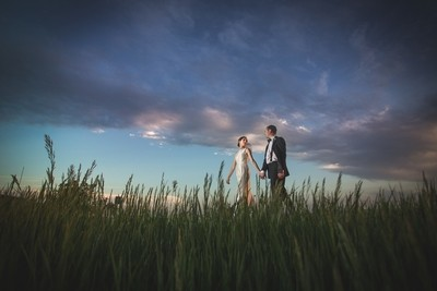 Sunset walk wedding couple in Kansas