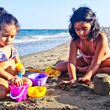 I took this photo when we went to the beach, with our Nephews, Mavi and Ada, in the summer of 2014. Our nephews Ada and Mavi were playing with the sand when I took this photo.