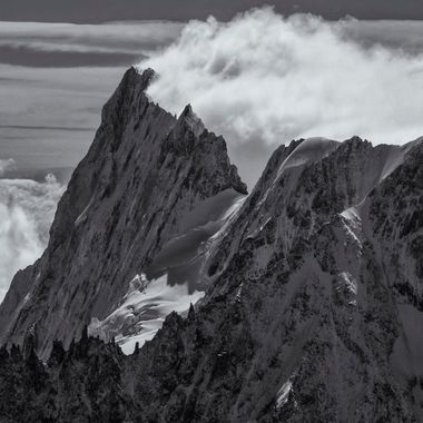 Dramatic cloud forming on the lee side of an Alpine Ridge in Chamonix.
