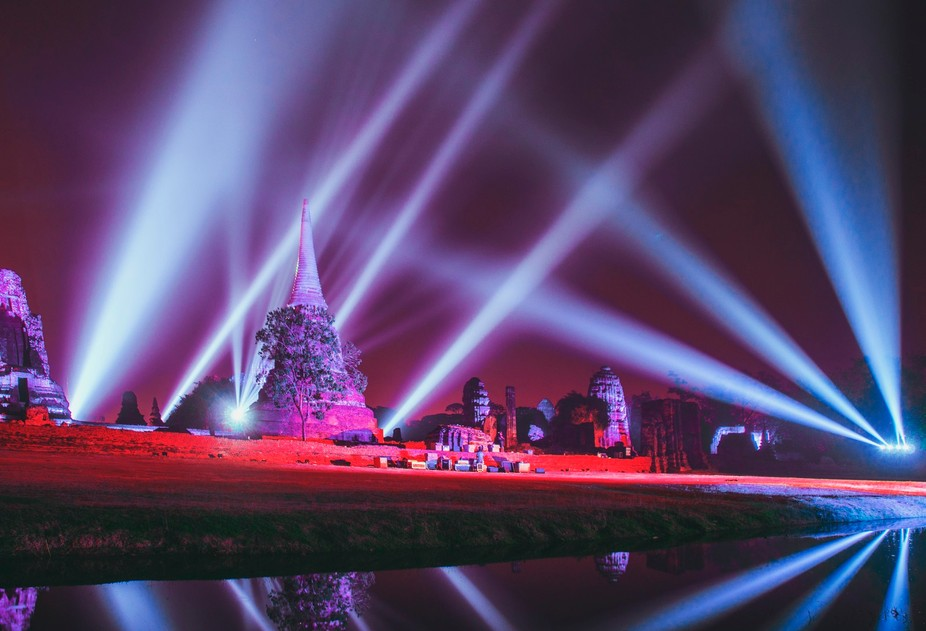 Light beams over wat/temple complex in old Siam kingdom, Ayutthaya, Thailand