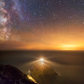 South Stack lighthouse under a starlit sky.   Sitting here in the shadow of the headland you will see a hundred satelites, shooting stars, meteor...