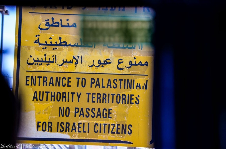 Was very disappointed to see this sign. Shot it through a bus window. No matter how you look at the situation in the Middle East, this sign is so wrong in more ways than one.