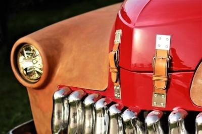 Close up of old vintage brown red car