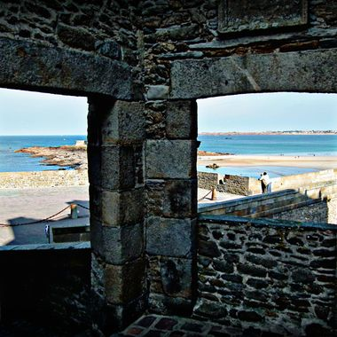 view through a double stone window from the walled city of St Malo.