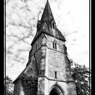 A quaint english church in B&W.