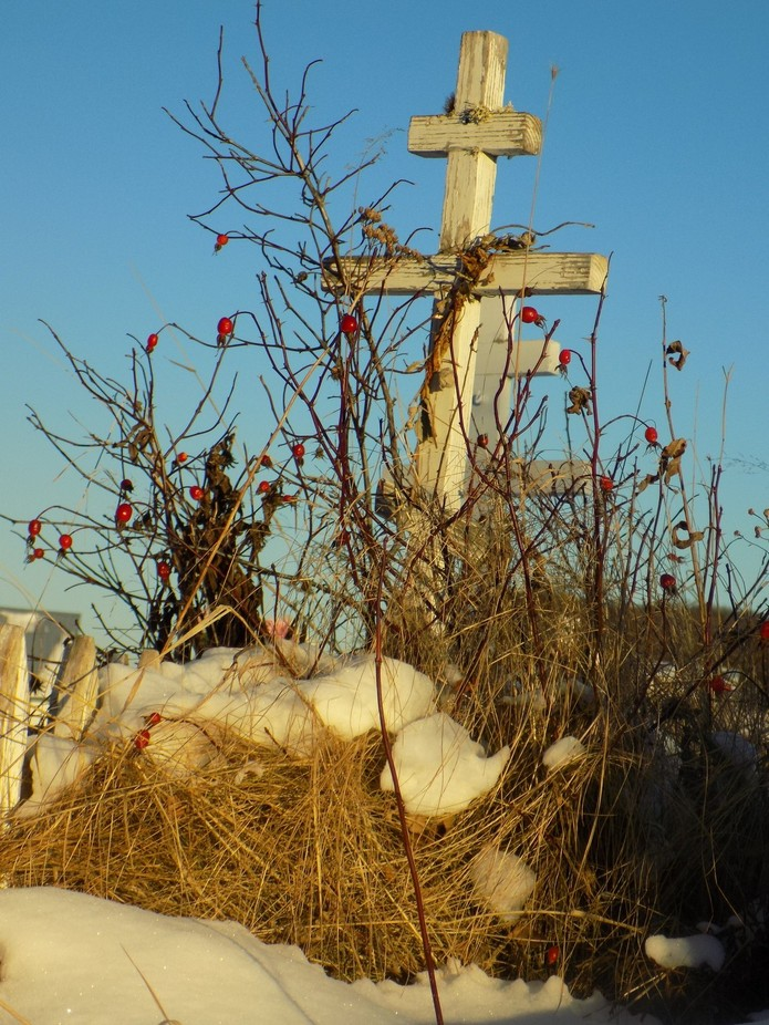This is a photograph I took of grave at a Russian Orthodox Church in Ninilchilk, Ak.