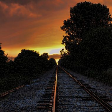 Captured in the early morning, a nice summer sunrise with the rails.