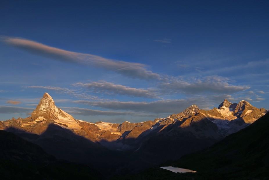 This was taken from Flue at dawn and shows the Matterhorn, Dent Blanche, Ober Gabelhorn and Wellenkuppe.
