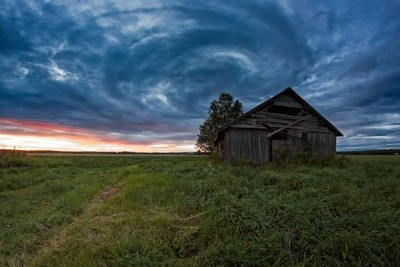 Circle Of Clouds Over The Old Barn House