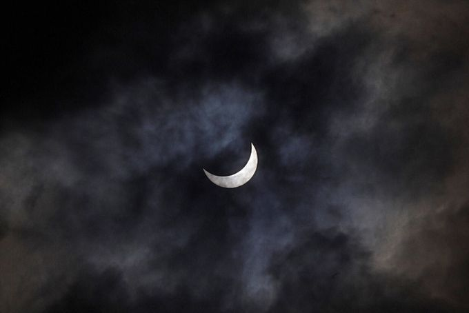 Eclipse Hidden In The Clouds by shaunbowles - 400 Solar Eclipse Shots Photo Contest