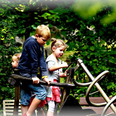 Children playing on the Play park at Münster Zoo.