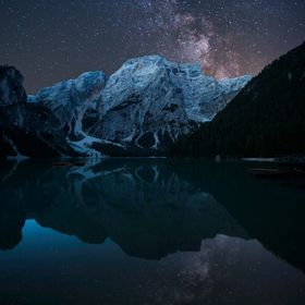 Composite of two photos taken a few hours apart at Lagos di Braies in The Dolomites, Italy
