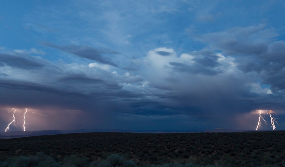Dual storms talking to each other with lightning.