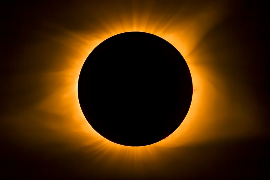 The moon covers the sun and displays the star's corona during totality. Photographed in ...
