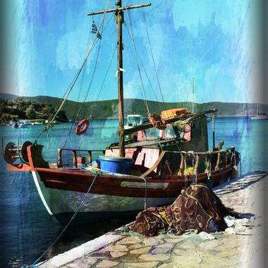 Fishing boat moored at Posidonio jetty.