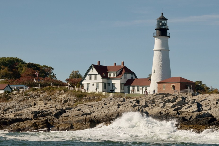 Portland Head lighthouse in Maine. I caught this shot just as the wave was crashing on the rocks....