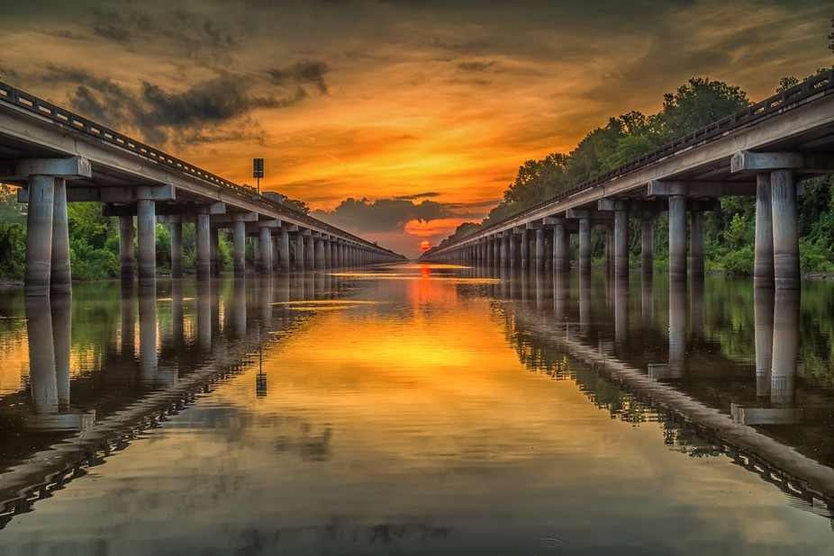 Sunrise on the Atchafalaya Basin.  This was a planned shot with the sun betweens the spans.