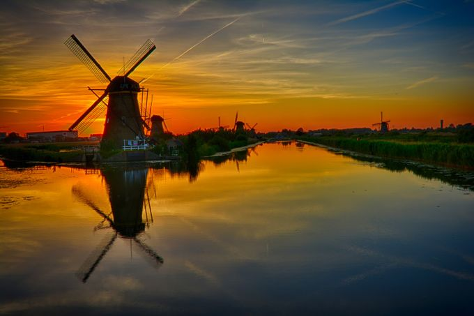 sunset over windmill. by pavvoo24 - Lakes And Reflections Photo Contest