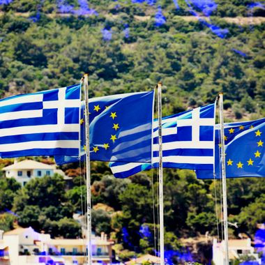 The Greek & Europe flags in Samos Town Greece.