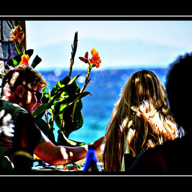 Couple and flower picture from Retaurant Haravgi , Samos.