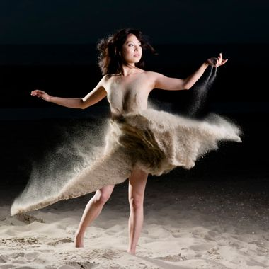 A night on the beach... An assistant threw sand from various angles and with varying speed at the model, which had to hold the pose. The final result is a composition from numerous shots. Model: Miya Sato (Model Mayhem # 3559858)