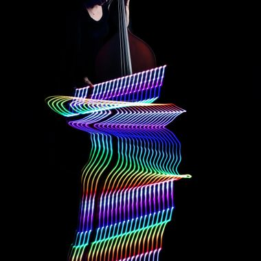 An LED strip was taped to the bow. The camera was moved during a long exposure in the dark, the exposure was finished with a flash on the second curtain.