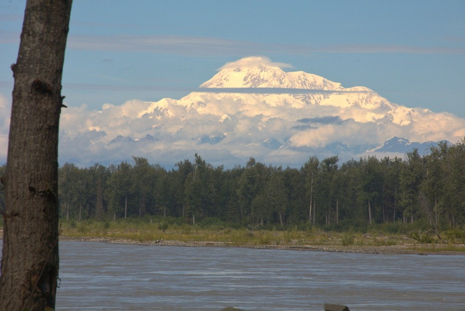 Denali (formerly Mount McKinley, as seen from the banks of the Susitna River in Talkeetna, Alaska...