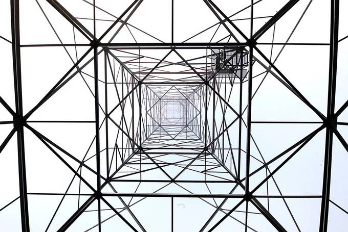 Standing underneath a power line tower looking up obviously :)