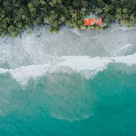 A one point aerial perspective of one of my favorite surf breaks on the coast of Manuel Antonio featuring my favorite local beach bar and local p...
