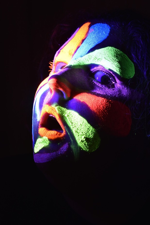 I painted my face with UV paint and used a blacklight for lighting.  This image is strait from th...
