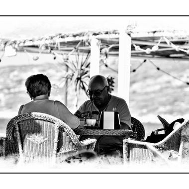 Couple breakfasting by the Sea.