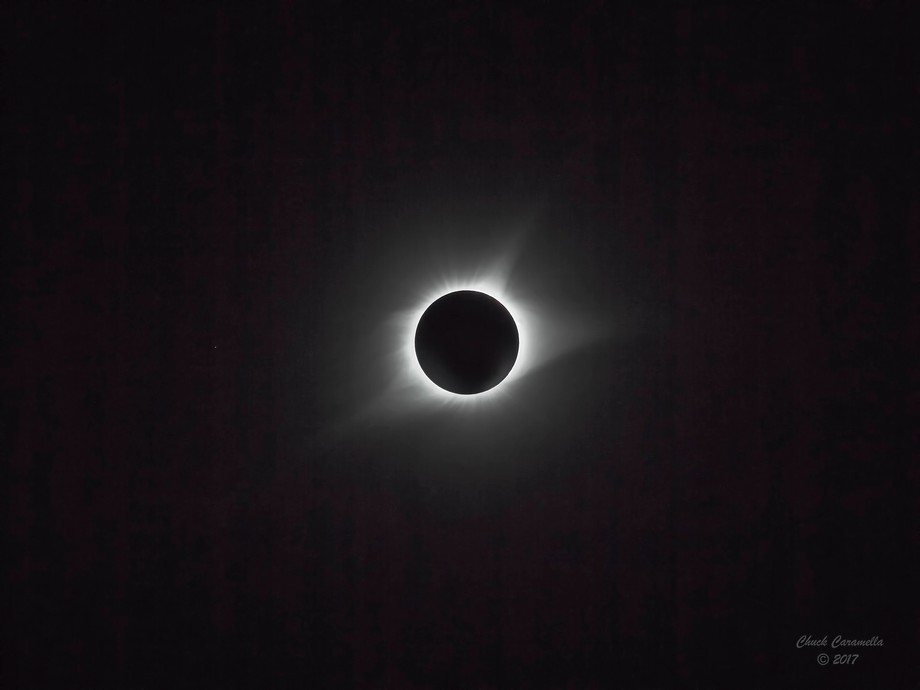 Photography - Digital Manipulation. Solar eclipse - August 2017. Small white dot to the left of the eclipse is the star Regulus.