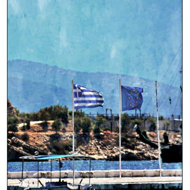 A Tattered Greek flag flying in Pithagorio, Samos, Greece.