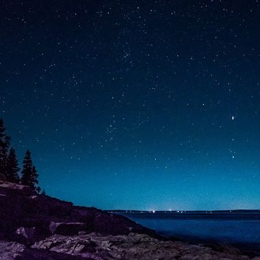 Otter Cliffs under the night sky in Acadia National Park