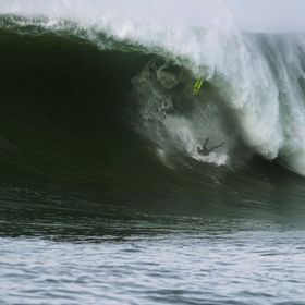 Nic Vaughn hits the deck at Mavericks after an amazing drop and attempt.  Total warrior!