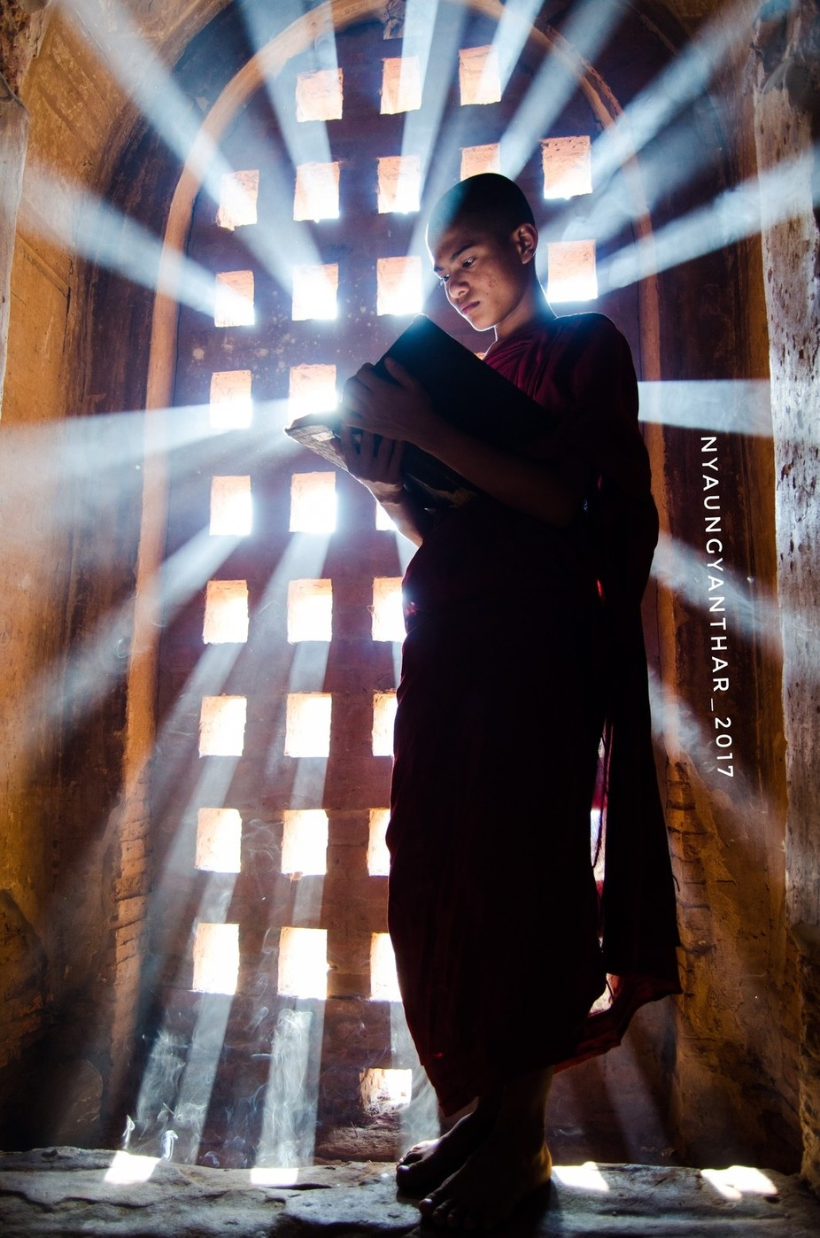 Young novice studying under the rays  by nyaungyanthar - Flares 101 Photo Contest
